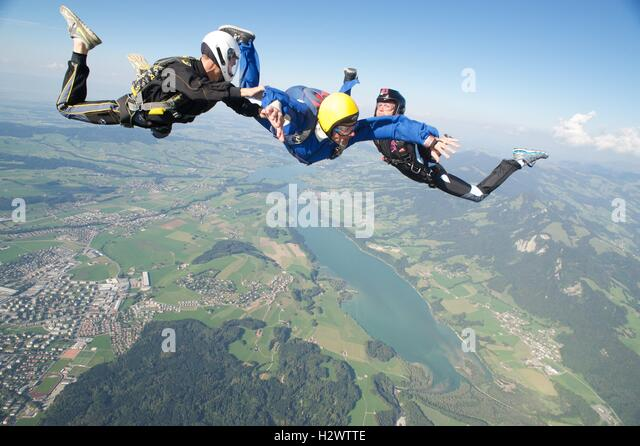 First jump student on a jump with two instructors - Stock Image