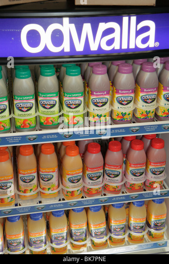 Washington DC product store refrigerator odwalla brand fruit juice shop shopping plastic bottle refrigerated display - Stock Image