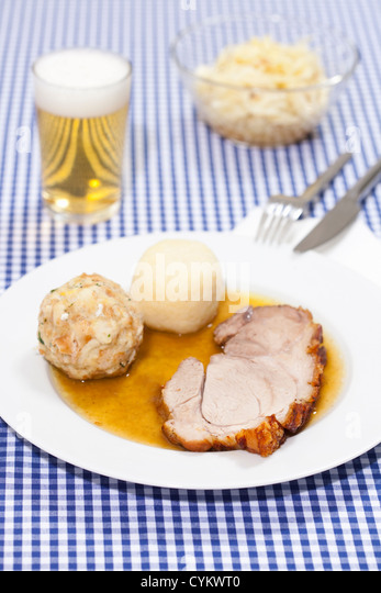 Plate of roast pork with dumplings - Stock Image