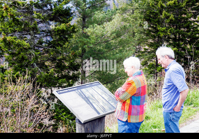 Tennessee Great Smoky Mountains National Park Newfound Gap senior couple information overlook - Stock Image