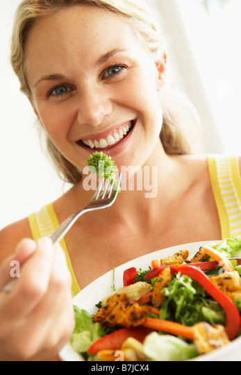 Mid Adult Woman Eating A Healthy Salad - Stock Image