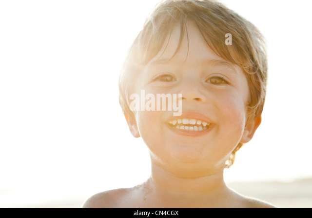 Happy boy in sunlight - Stock Image