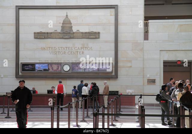 Washington DC United States US Capitol Emancipation Hall Visitor Center tour information desk roped line Black man - Stock Image