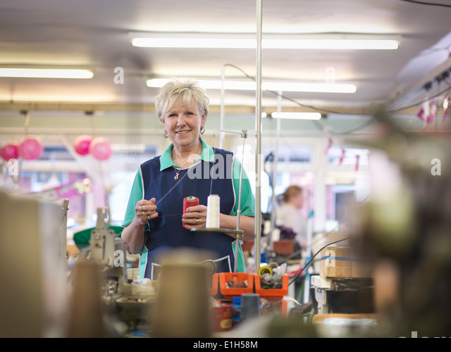 Manageress of clothing factory, portrait - Stock Image