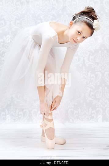 Cute little ballerina before crucial performance - Stock Image
