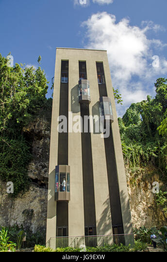 Outdoor elevators for reaching Harrison's Cave tour in Barbados uplands. - Stock Image