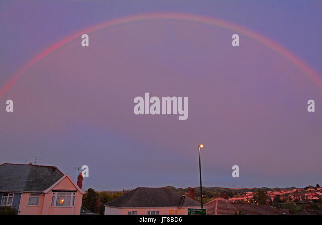 Bristol, UK. 07th Aug, 2017. UK Weather. A pink rainbow seen over the Whitchurch area of Bristol late in the evening. - Stock Image