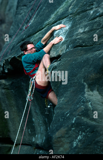 PICTURE CREDIT DOUG BLANE Dave Felce rock climbing in Derbyshire Peak District National Park Great Britain - Stock Image