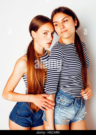 two cute teenagers having fun together isolated on white - Stock Image