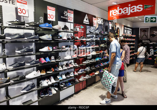 Spain Europe Spanish Hispanic Madrid Centro El Corte Ingles department store shopping shoe department athletic shelves - Stock Image