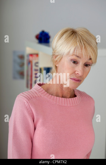 WEARY ELDERLY PERSON - Stock Image