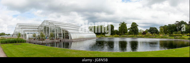Panorama of the Glasshouse and lake at RHS Wisley - Stock Image