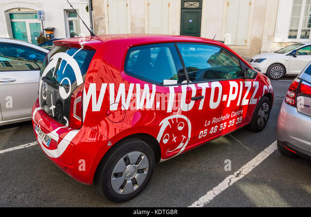 Toto-Pizza advertising on Volkswagen Polo car, La Rochelle, France. - Stock Image
