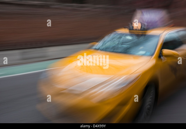 Yellow taxicab blurred to show movement Stock Photo
