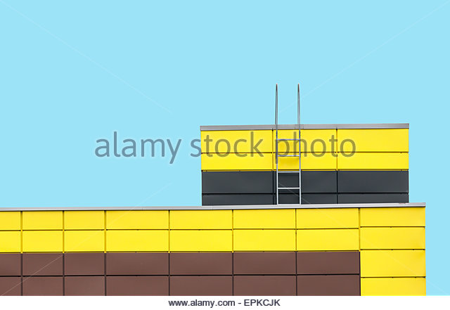 Abstract architecture picture. Multicolored building facade on flat cyan color background - Stock Image