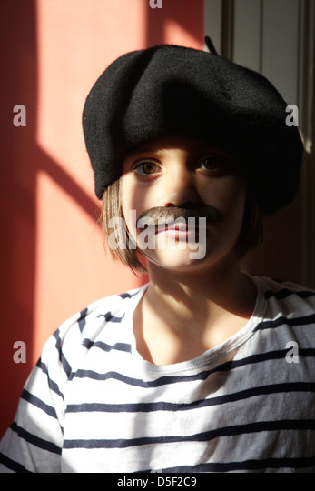 9 year old girl with moustache - Stock Image