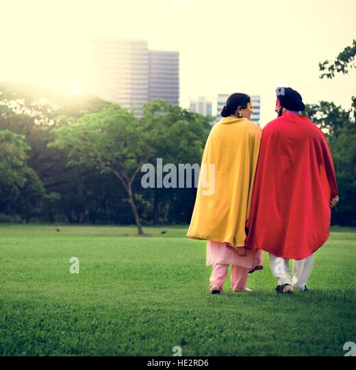 Indian Couple Superheroes Love Concept - Stock Image