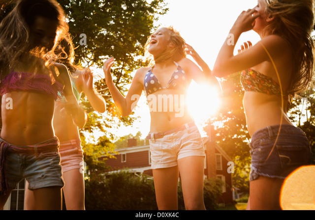 Girls dancing in garden - Stock Image