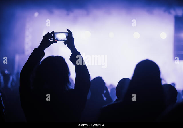 Finland, Uusimaa, Helsinki, Woman using smart phone on concert - Stock-Bilder