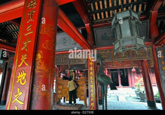 Woman in a Pavilion in the Temple of Literature, a Confucius temple, Hanoi, Vietnam - Stock Image
