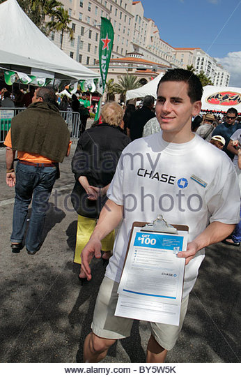 Miami Coral Gables Miami Florida Carnaval on the Mile Hispanic festival survey man survey opinion questionnaire - Stock Image