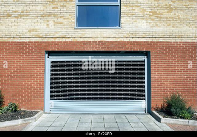 Electronic garage gate. - Stock Image