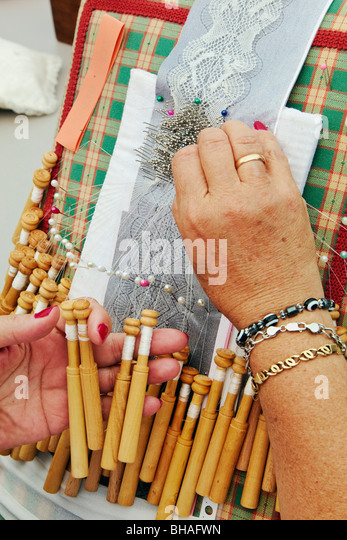 Woman doing traditional lace-making - Stock Image