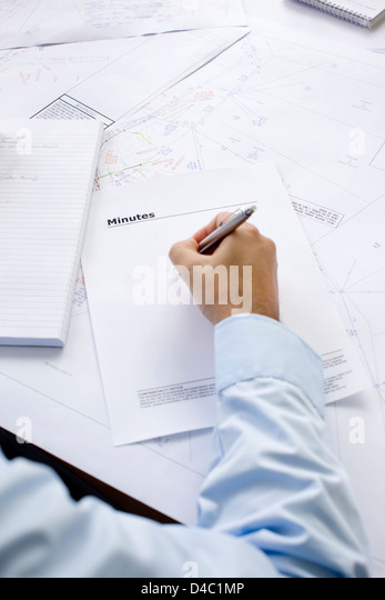 Man recording minutes of meeting - Stock Image