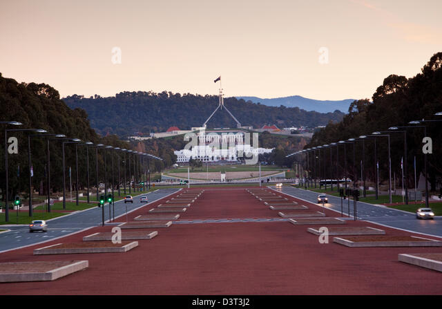 View along Anzac Parade to Parliament House at twilight. Canberra, Australian Capital Territory (ACT), Australia - Stock Image