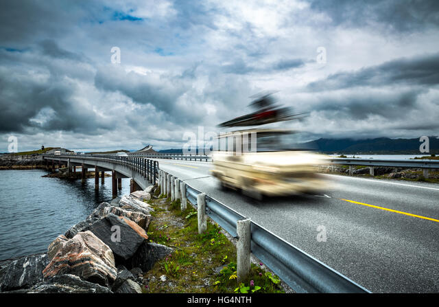 Car travels on the highway. Caravan Car in motion blur. Norway. Atlantic Ocean Road or the Atlantic Road (Atlanterhavsveien) - Stock Image