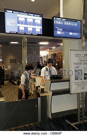 Japan Tokyo Haneda Airport kanji hiragana katakana characters symbols Japanese English gate area boarding agents - Stock Image