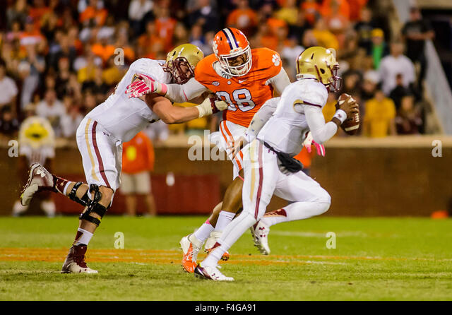 Boston College Eagles quarterback Jeff Smith (5) evades Clemson Tigers defensive end Kevin Dodd (98) during the - Stock Image
