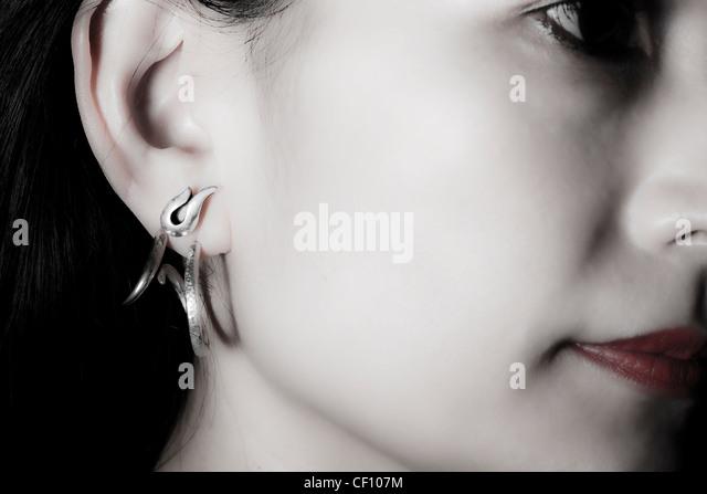 Close up of an asian, young, beautiful woman - Stock Image