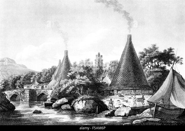 GLASS MAKING FURNACES alongside the River Exe, near Exeter, England in 1798. Engraving based on a painting by John - Stock-Bilder