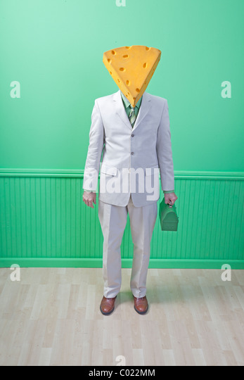 cheese head in suit with green lunch box - Stock Image