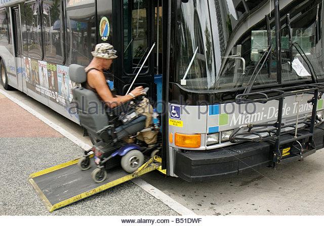 Miami Florida Omni Station Metrobus bus mass transit public transportation man electric wheelchair handicap disabled - Stock Image