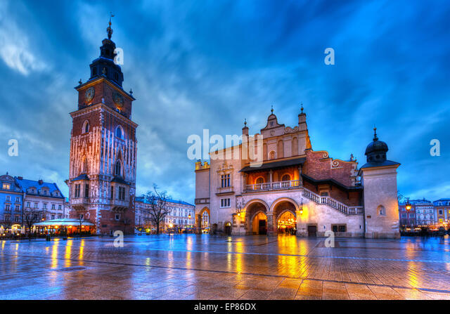 The Town Hall Tower and the Cloth Hall in the main square of Krakow, Poland - Stock Image