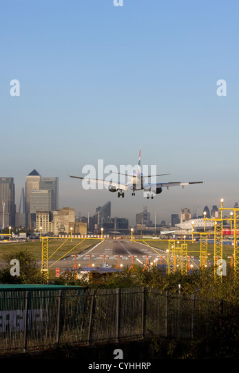 British Airways regional airliner landing at London City Airport, England, UK - Stock Image