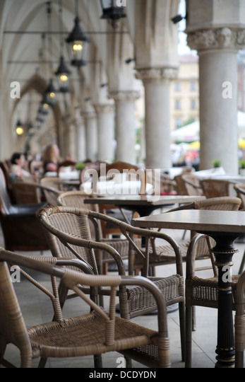 Picture presenting wicker furniture in old restaurant - Stock Image