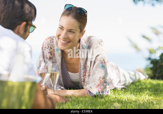 Couple drinking champagne outdoors - Stock Image
