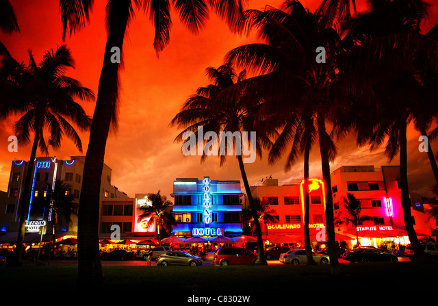 Art deco hotels with neon lights on Miami Beach at sunset - Stock Image