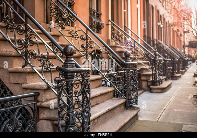 Brownstone Apartment steps in the Chelsea neighborhood of New York City. - Stock Image