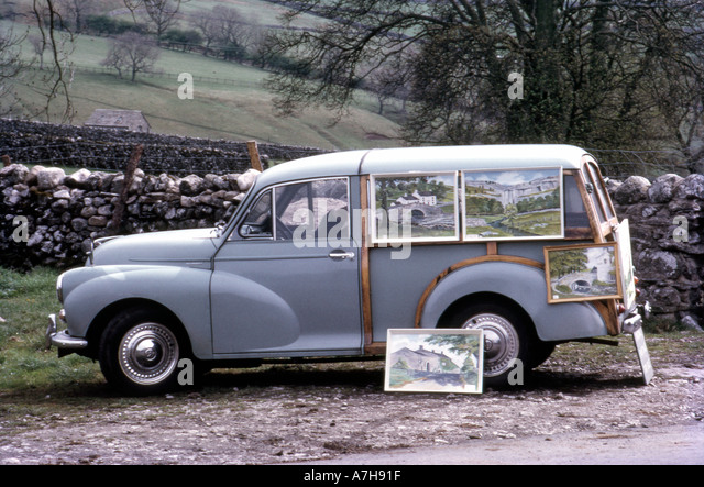 A Morris Minor 1000 Traveller estate car being used as an exhibition stand for oil paintings in Yorkshire England - Stock Image