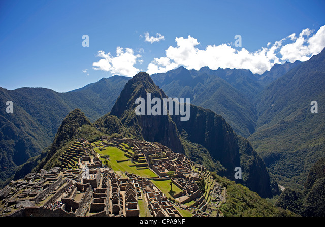 The Inca ruins of Machu Picchu with Huaynu Picchu and the Andes Mountains behind in the Sacred Valley of Peru at - Stock Image