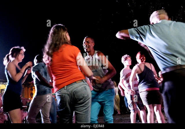 People dance Salsa with passion at an open air, outdoor, street party, near Casa Del Musica in Trinidad, Cuba, founded - Stock Image