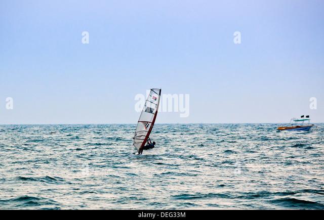 Person wind surfing in the sea, Candolim, Calangute, Bardez, North Goa, Goa, India - Stock Image