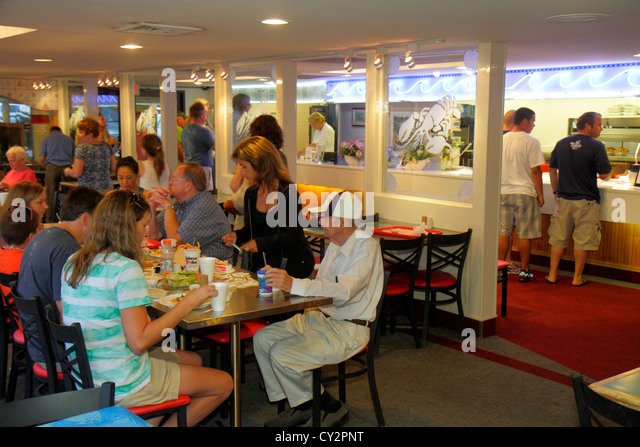 Massachusetts Plymouth Water Street Town Wharf Lobster Hut restaurant seafood dinner counter inside food table diners - Stock Image