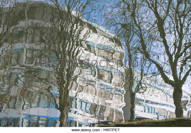 Modern architecture abstract, exterior office building reflected in water ripples Berlin Schöneberg - Stock Image