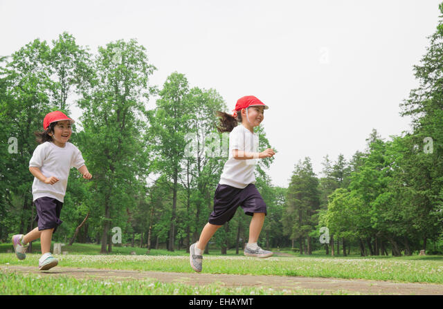 Japanese kids playing in a park - Stock Image