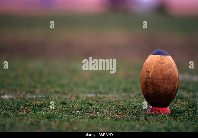 Rugby ball on tee - Stock Image